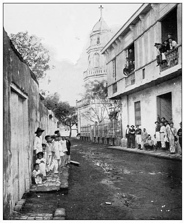 Antique black and white photograph of people from islands in the Caribbean and in the Pacific Ocean; Cuba, Hawaii, Philippines and others: San Pedro, Cavite, Philippines