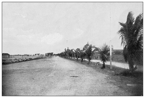 Antique black and white photograph of people from islands in the Caribbean and in the Pacific Ocean; Cuba, Hawaii, Philippines and others: Santa Lucia drive, Manila, Philippines