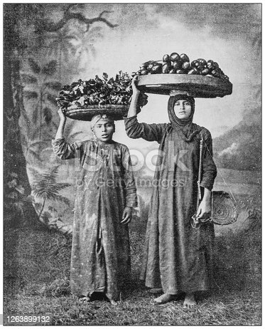 Antique black and white photograph: Suez grocery vendor