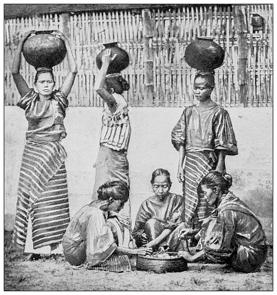 Antique black and white photograph of people from islands in the Caribbean and in the Pacific Ocean; Cuba, Hawaii, Philippines and others: Water carriers and fruit vendors, Manila, Philippines