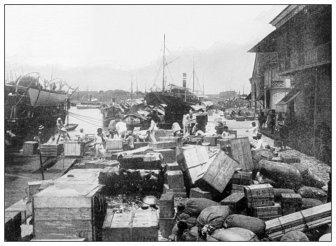 Antique black and white photograph of people from islands in the Caribbean and in the Pacific Ocean; Cuba, Hawaii, Philippines and others: Wharf and Bay, Manila, Philippines