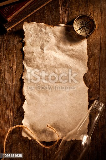 istock Antique blank piece of paper with a message from bottle 1036181638