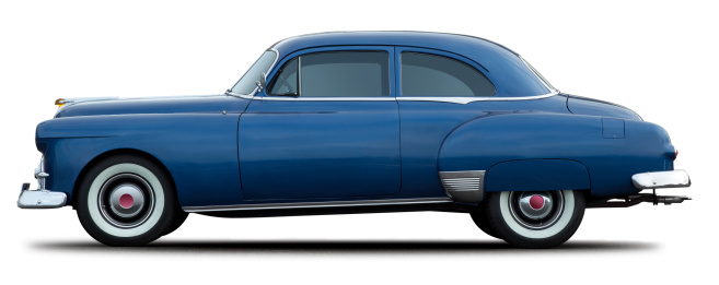 This is a side view of a antique blue car isolated on a white background. There is a clipping path included with this file.Click on the links below to view lightboxes.