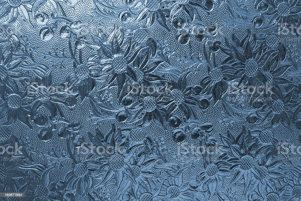 antique blue glass window panel with daisy inlay stock photo