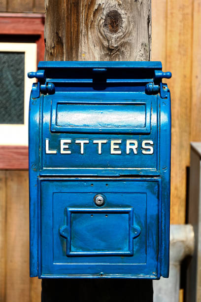Antique Blue Letter Box on the Telegraph made of wood. Antique Blue Letter Box on the Telegraph made of wood. Anglo American stock pictures, royalty-free photos & images