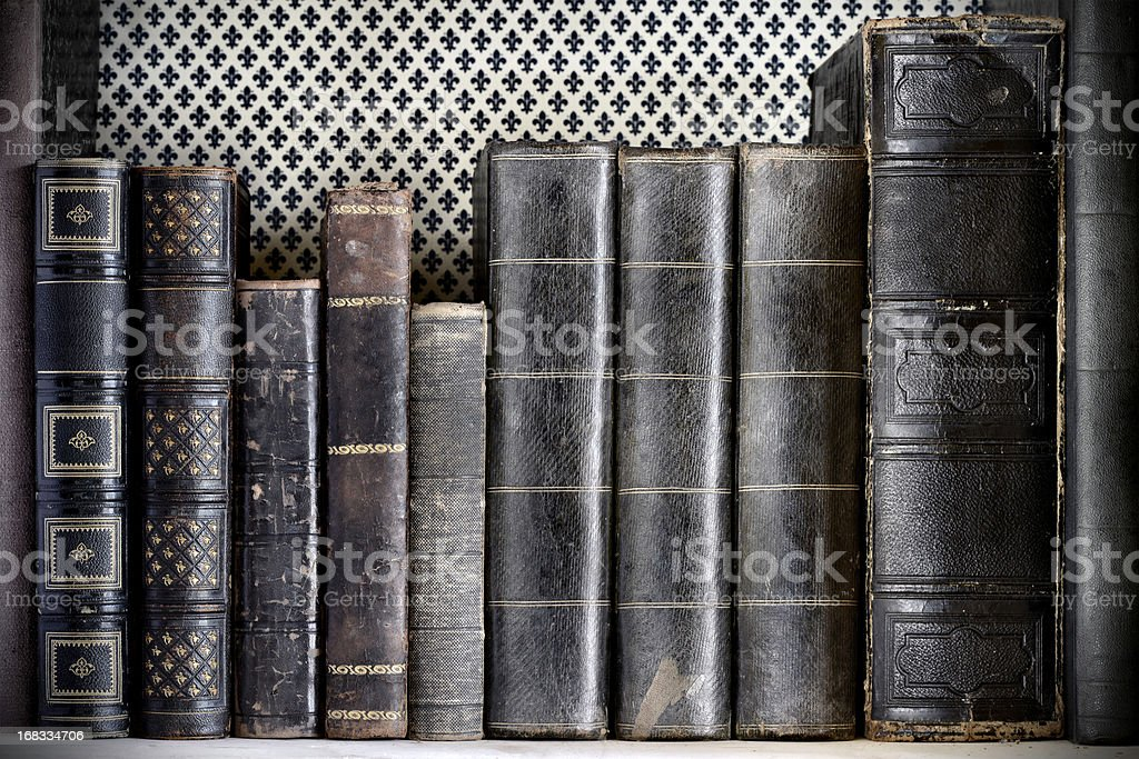 Antique book on a shelf stock photo