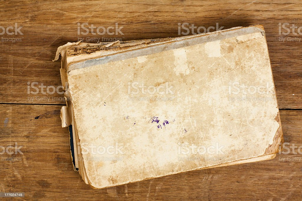 Antique book on wooden background stock photo