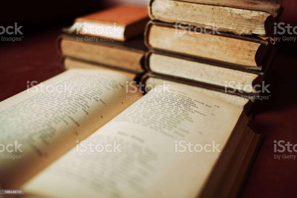 antique book open for reading stock photo