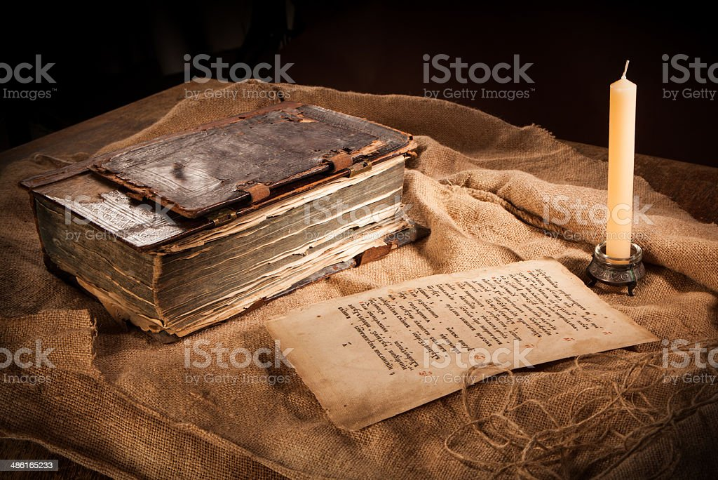 antique book, paper and candle stock photo