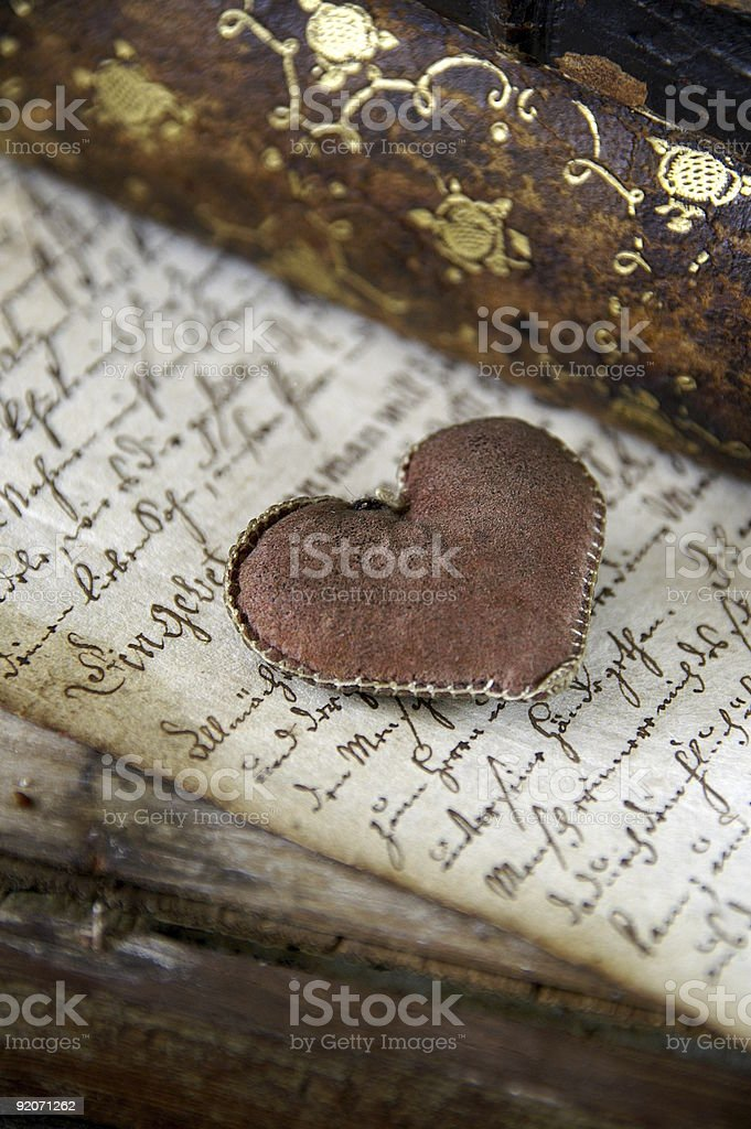 Antique book with heart royalty-free stock photo
