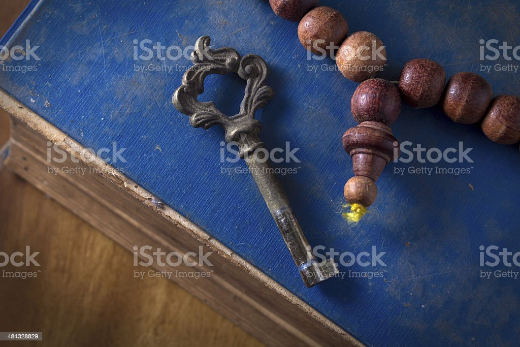 Antique book with necklace and key. royalty-free stock photo