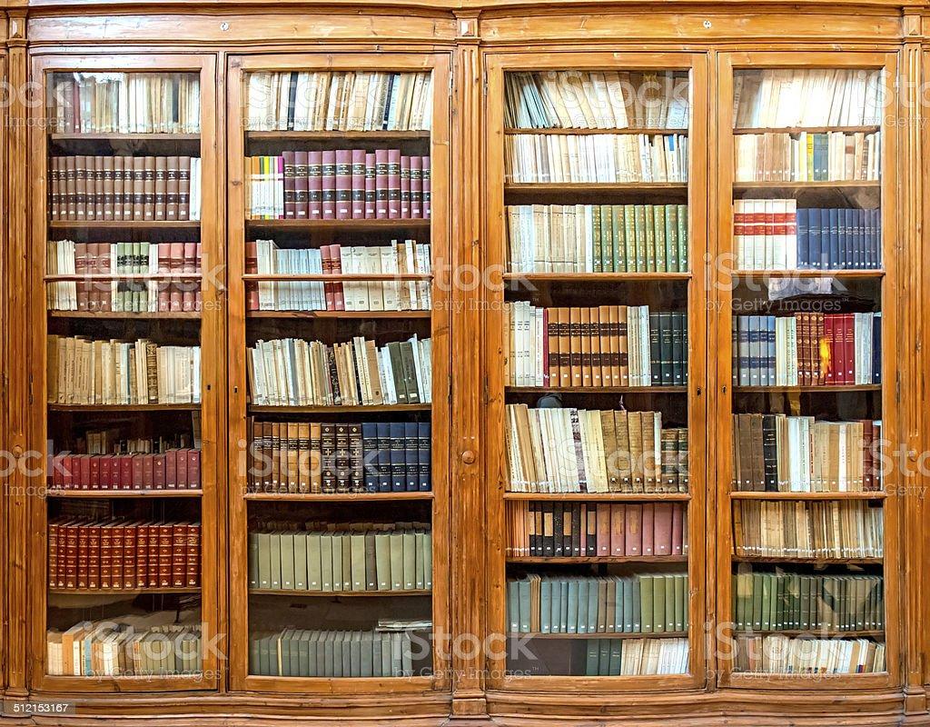 Antique bookcase stock photo