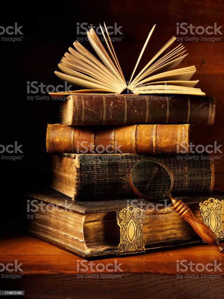 Antique Books and a Magnifying Glass stock photo