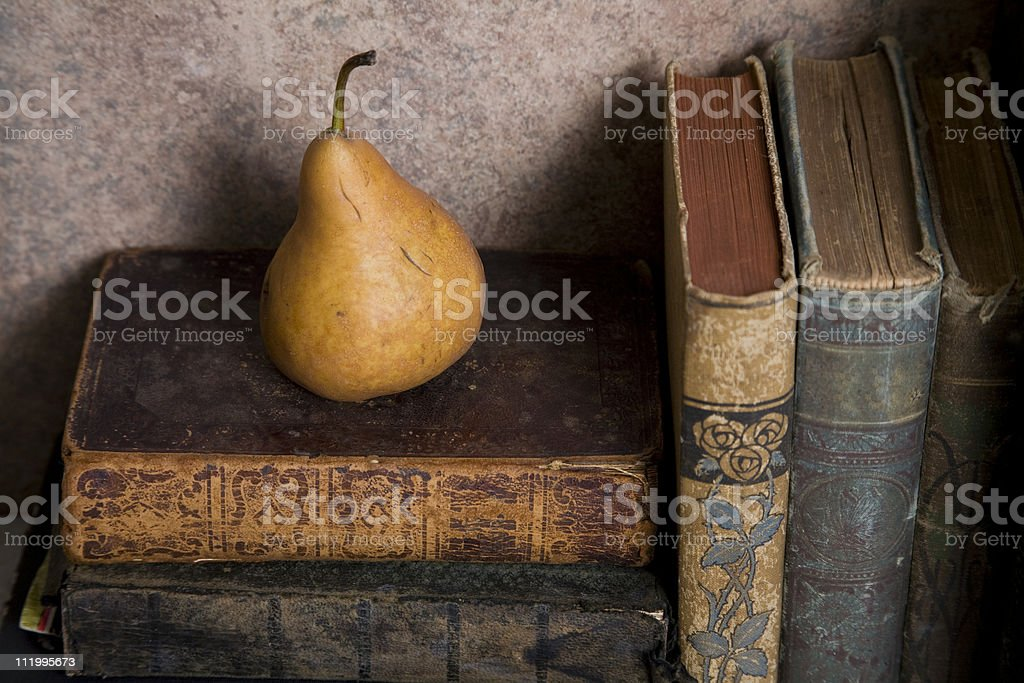 antique books and a pear royalty-free stock photo