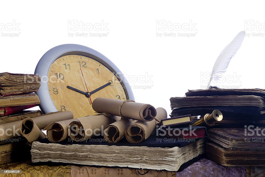 Antique books and scrolls on writing table royalty-free stock photo