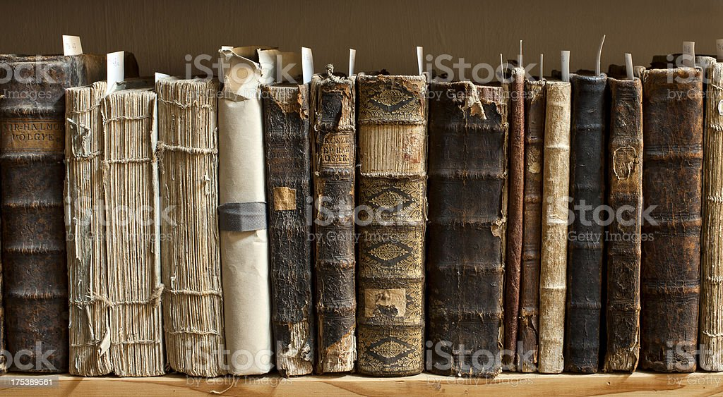 Antique books in a library royalty-free stock photo