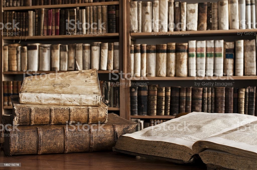 Antique books in a library stock photo