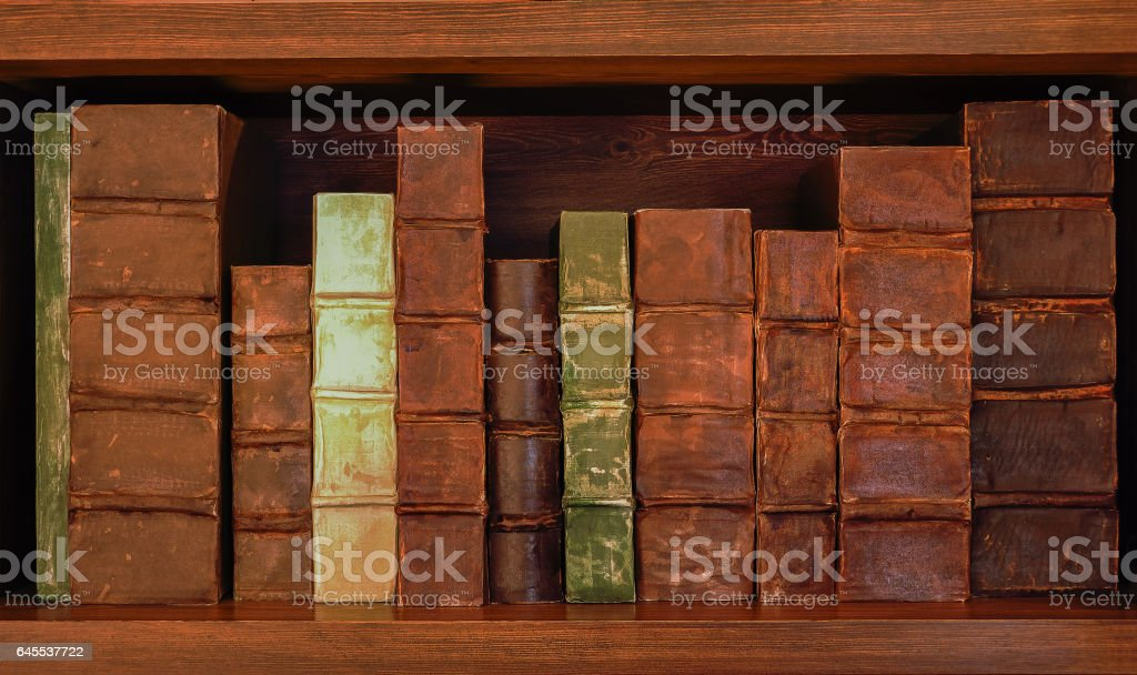 Antique books on old wooden shelf. Shelf with old books. stock photo