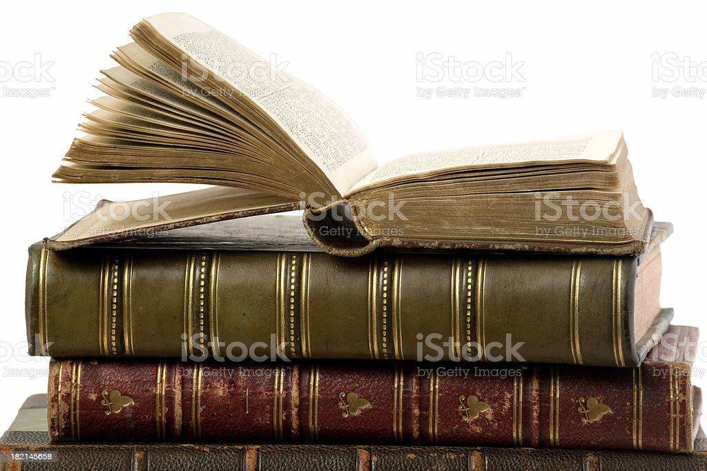 """Antique Books """"A stack of antique books, with the book open."""" Advice Stock Photo"""