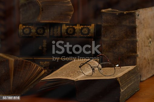 istock antique books with reading glasses in a dusty room 537881816