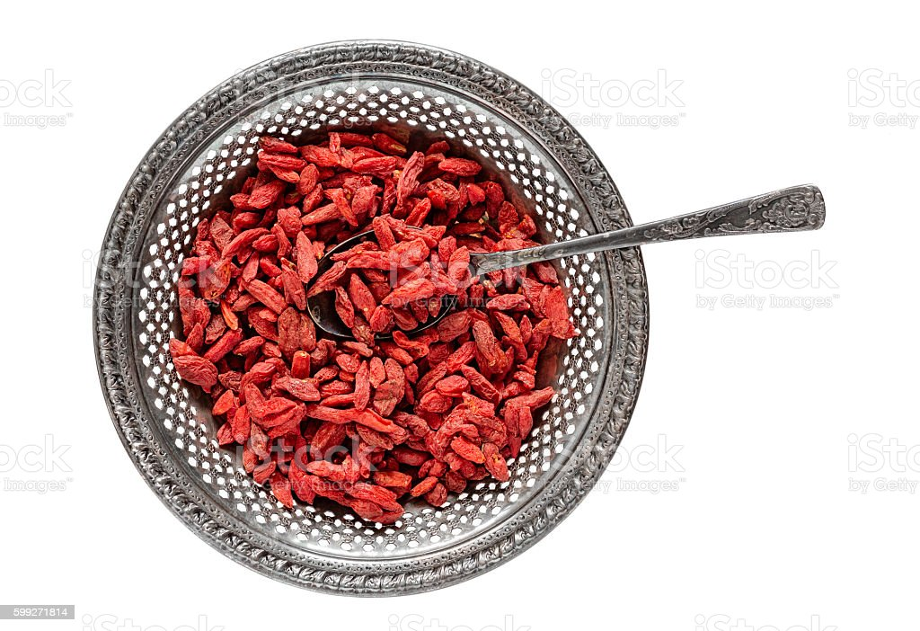 Antique Bowl of Dried Goji Berries stock photo
