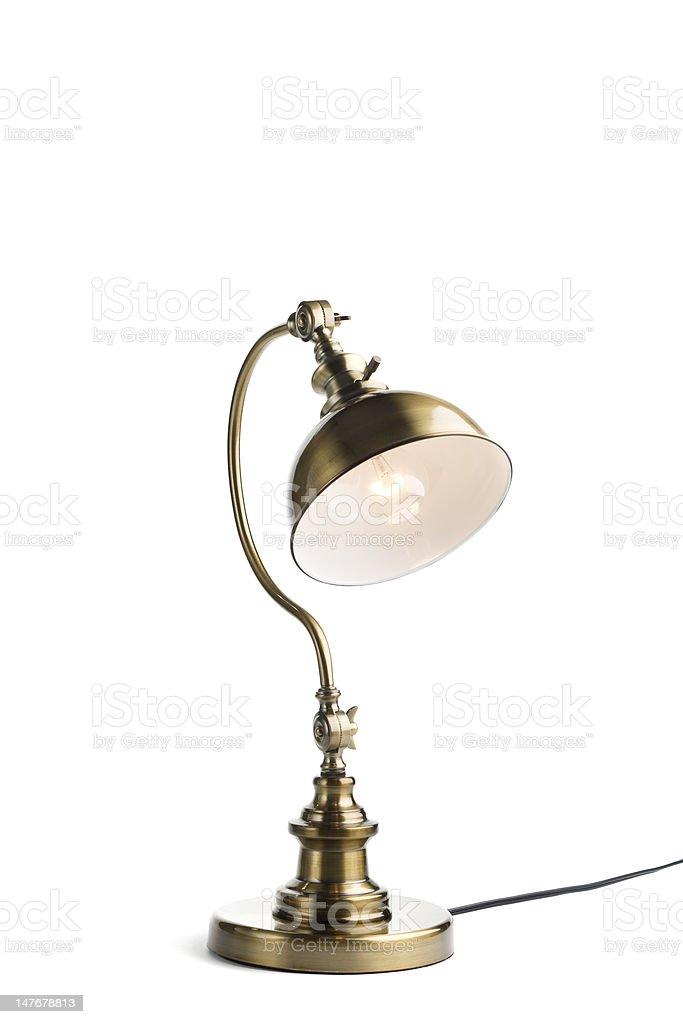 Antique brass lamp lit stock photo