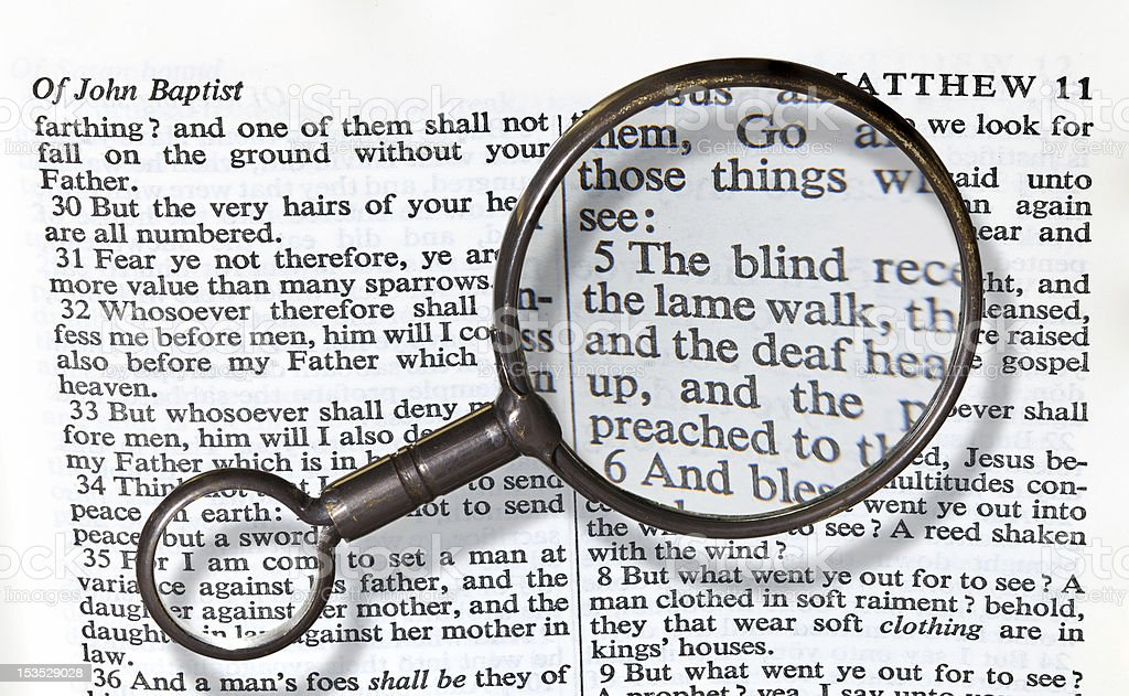 Antique brass magnifying glass stock photo