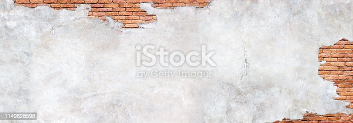 Damaged plaster on brick wall background. Brickwork under crumbling texture  concrete surface