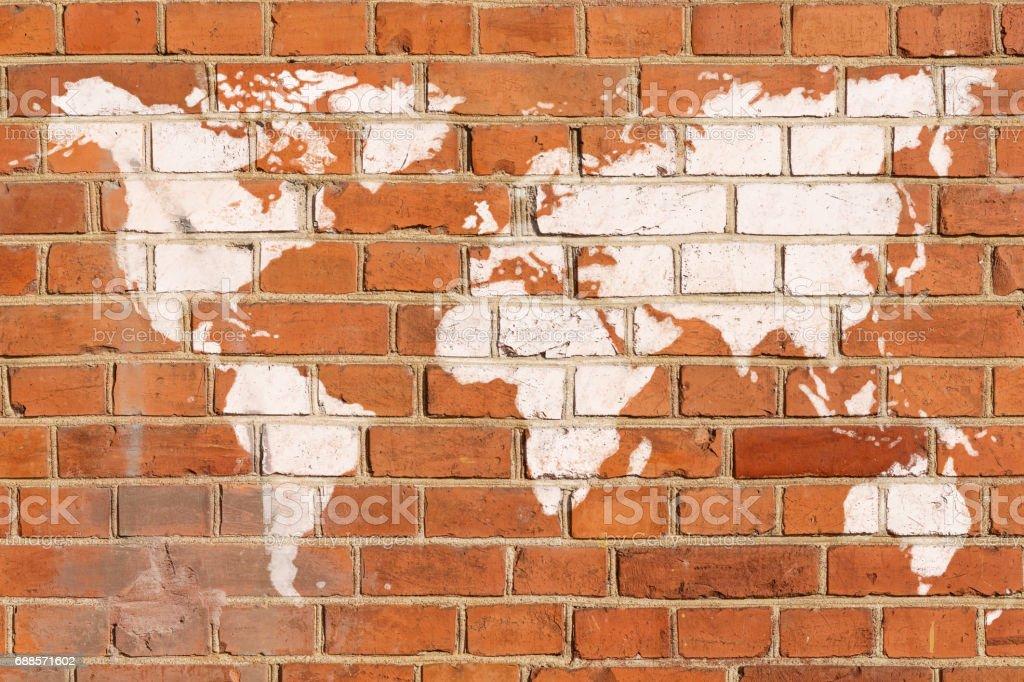 Antique brick wall with World map graffiti stock photo