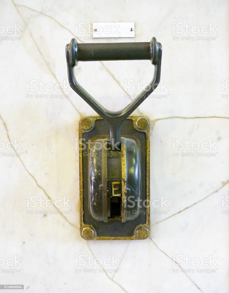 Antique bronze power switch stock photo