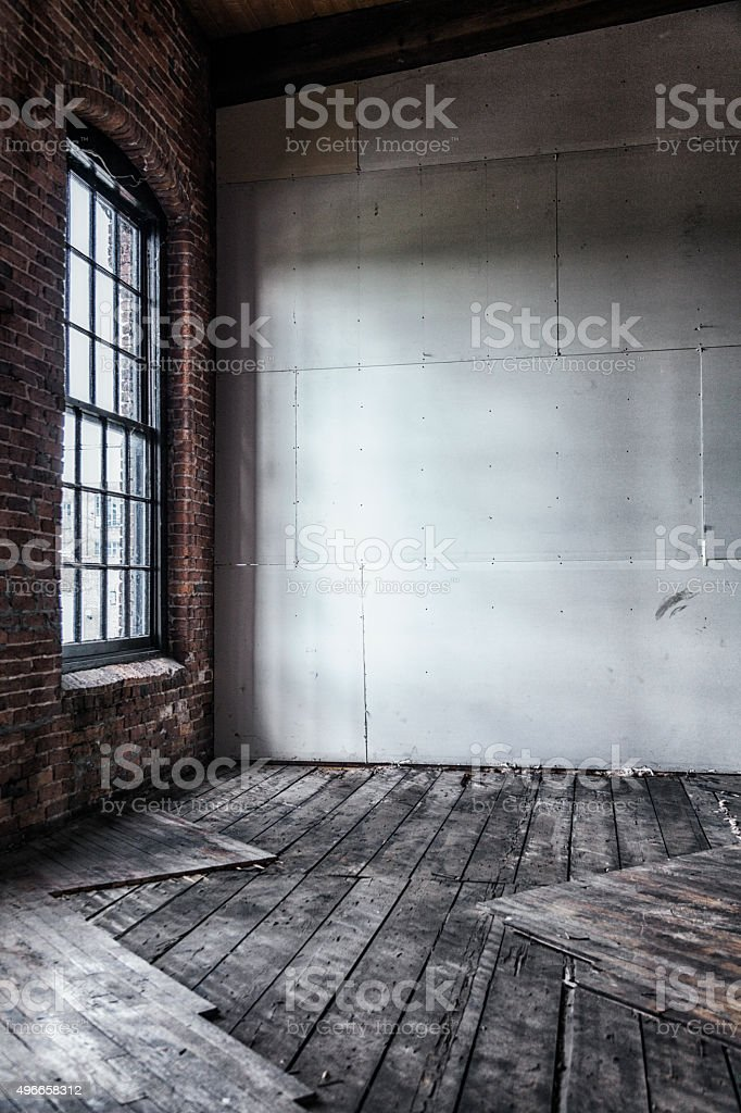 A once abandoned antique manufacturing building interior with very...