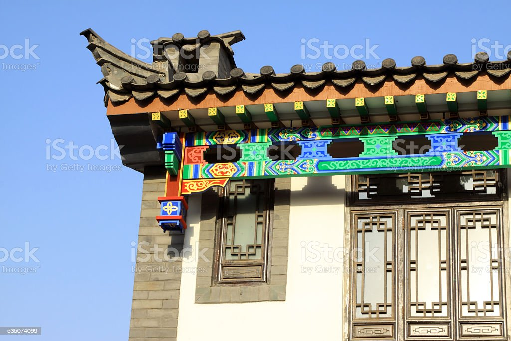 antique building under the blue sky in a park stock photo