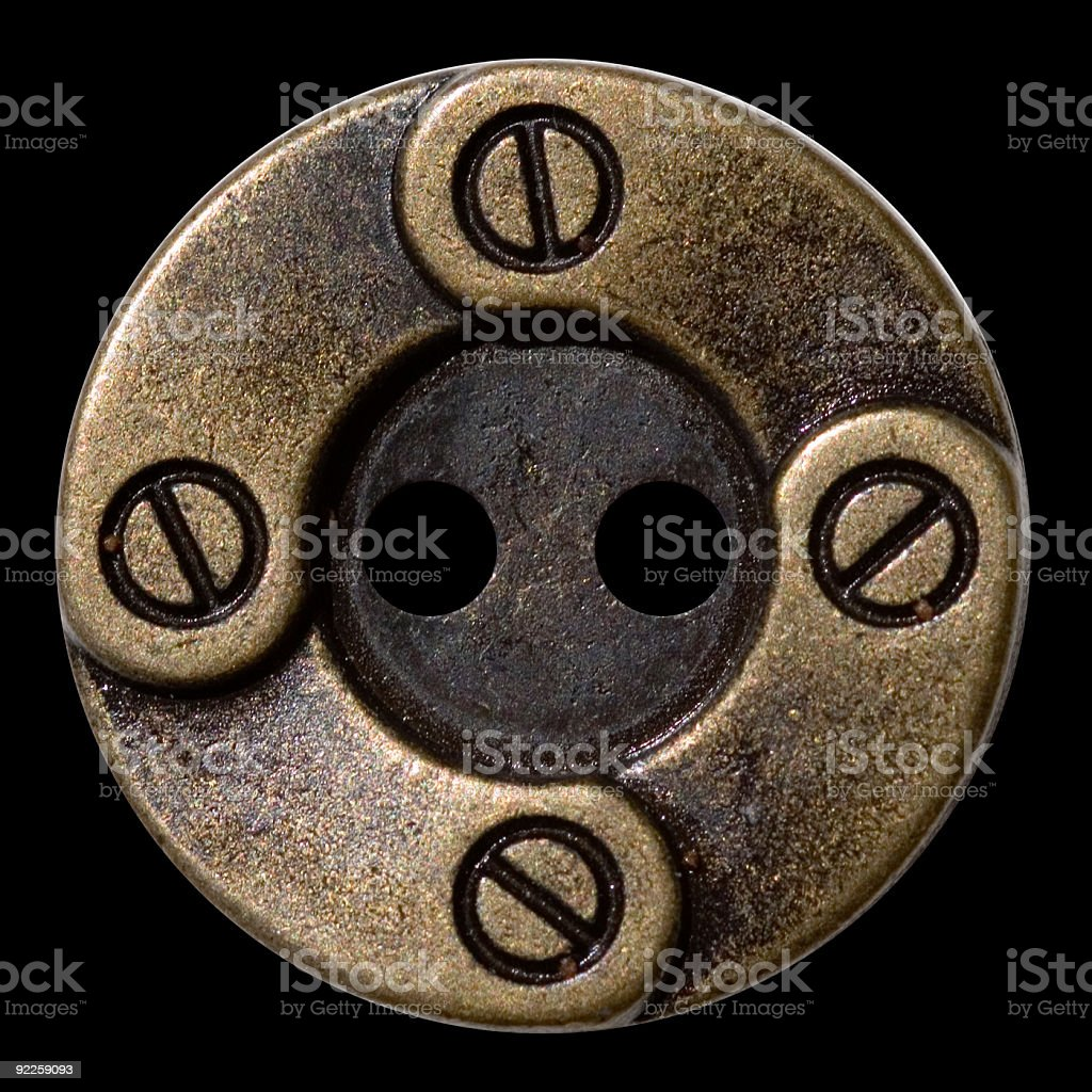 Antique Button - Brass with screws stock photo