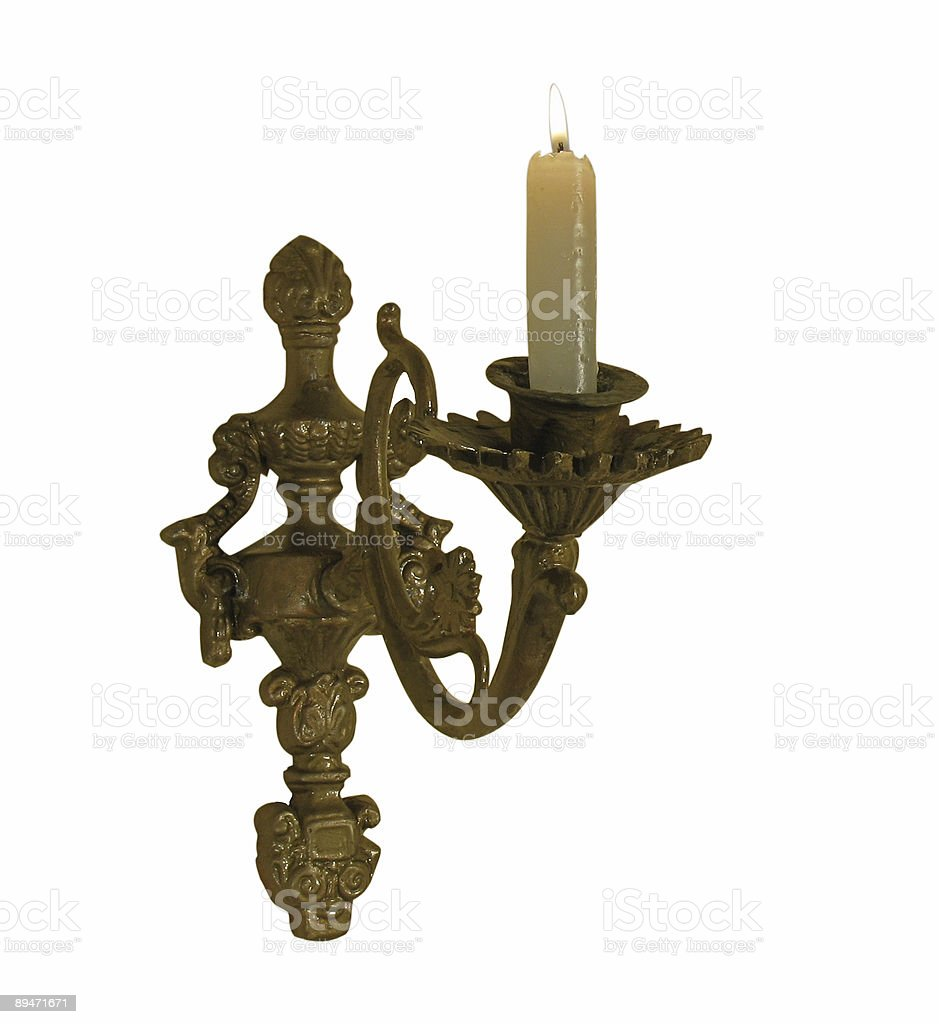 Antique candlestick with a burning candle. royalty-free stock photo