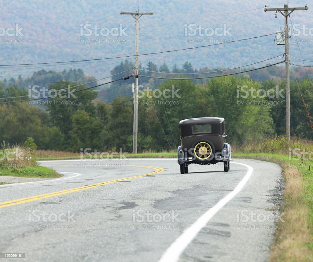 Antique Car on Rural Highway royalty-free stock photo