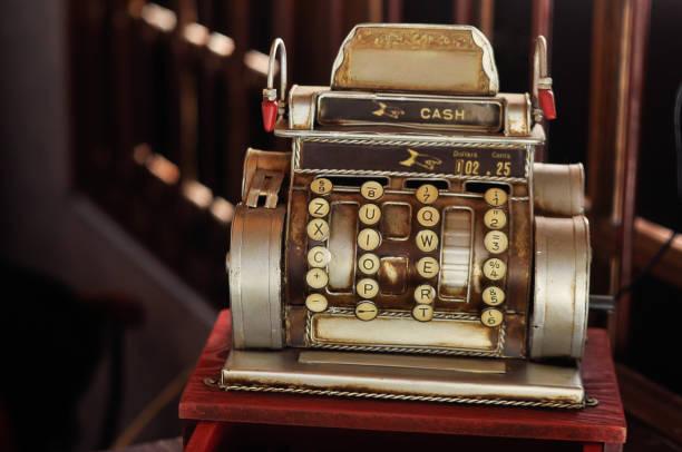 Antique cash register machine retro in a shop stock photo