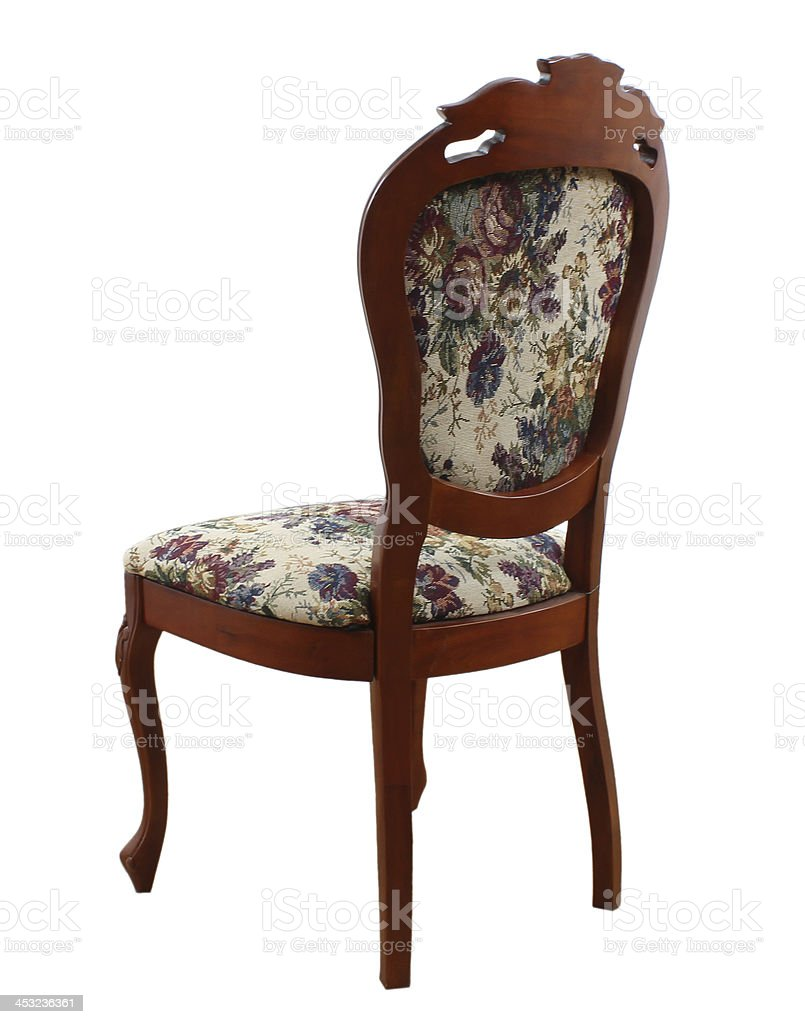 Antique chair with floral upholstery stock photo