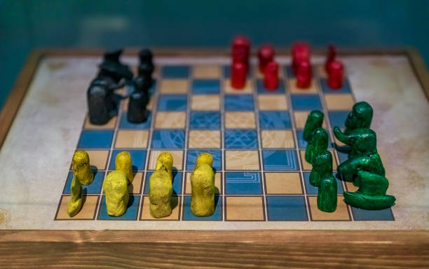 Antique chaturanga game board with pieces stock photo