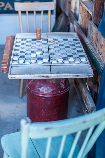 Antique checkers game in progress stock photo