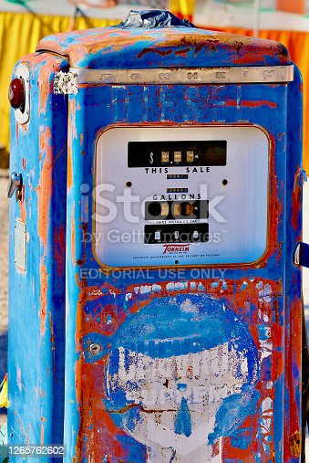 Seligman, Arizona, USA - July 30, 2020: An antique Chevron gas pump is one of many unique items at Delgadillo's Snow Cap drive-in, an iconic landmark along historic Route 66 in the heart of Seligman, Arizona.
