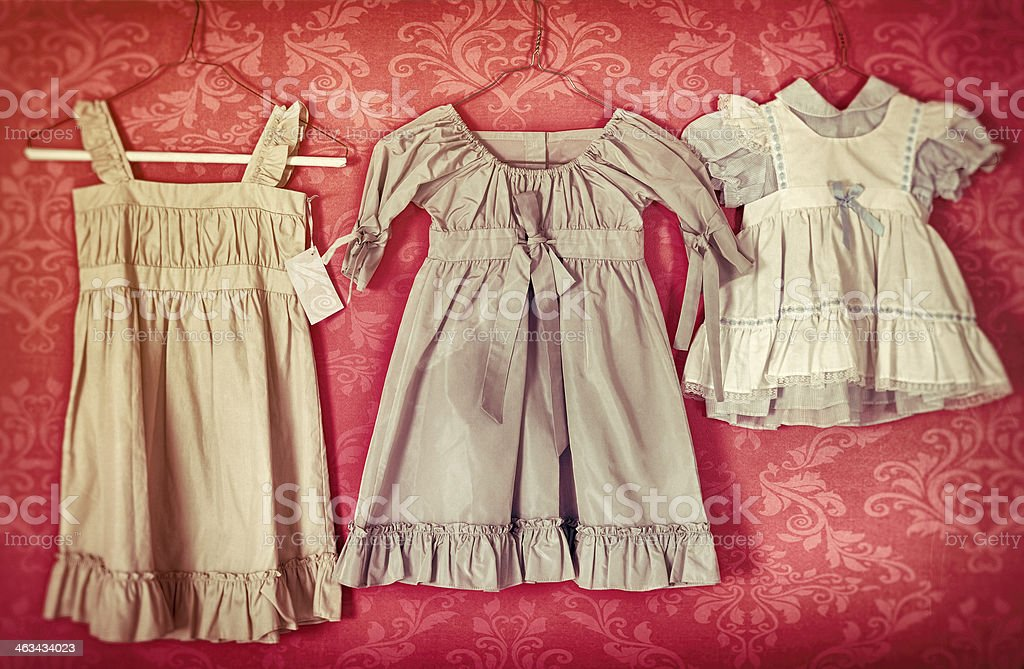Antique Childs Dresses On Hangers In A Row Stock Photo Download Image Now Istock