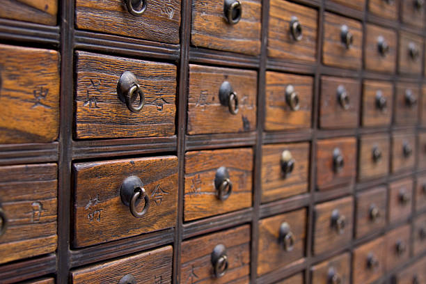 Antique Chinese Medicine Chest An antique chest used to store chinese medicinal herbs chinese herbal medicine stock pictures, royalty-free photos & images