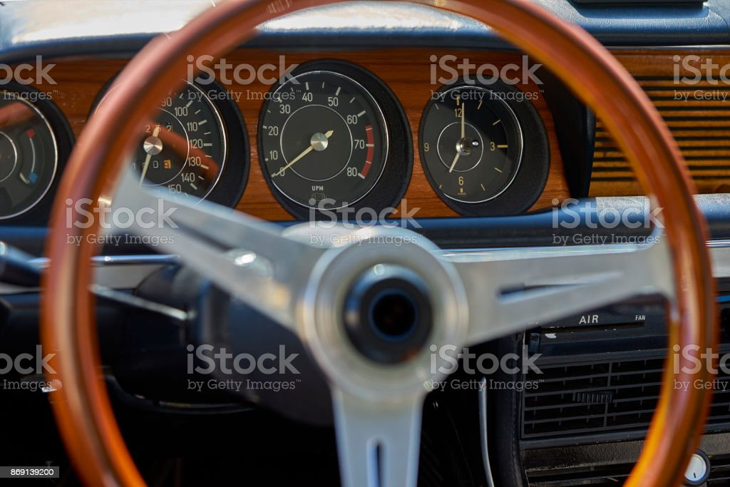 antique classic wood steering wheel and dashboard in German vintage car stock photo
