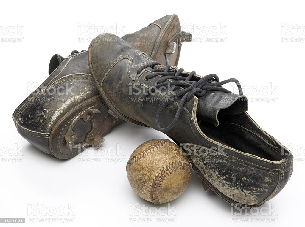 Antique cleats and baseball on white stock photo