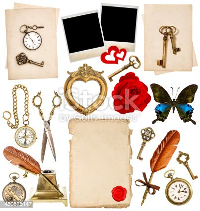 1129542015 istock photo antique clock, key, photo frame, feather pen, butterfly 480525147