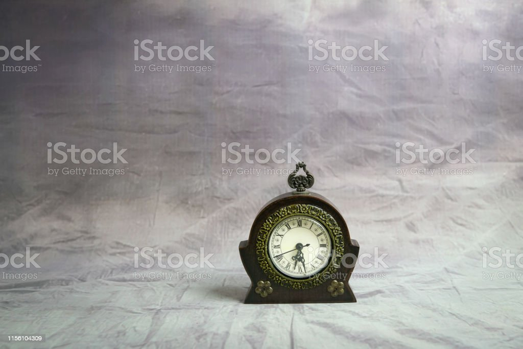 Antique clock on grunge background with copy space. Time concept.