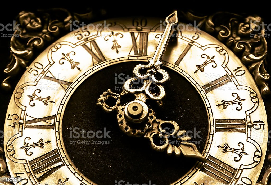 Antique, gold colored clock with original texture.