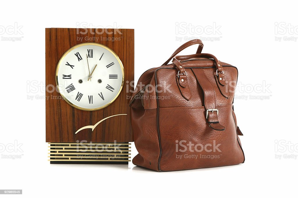 Antique clock with road bag royalty-free stock photo