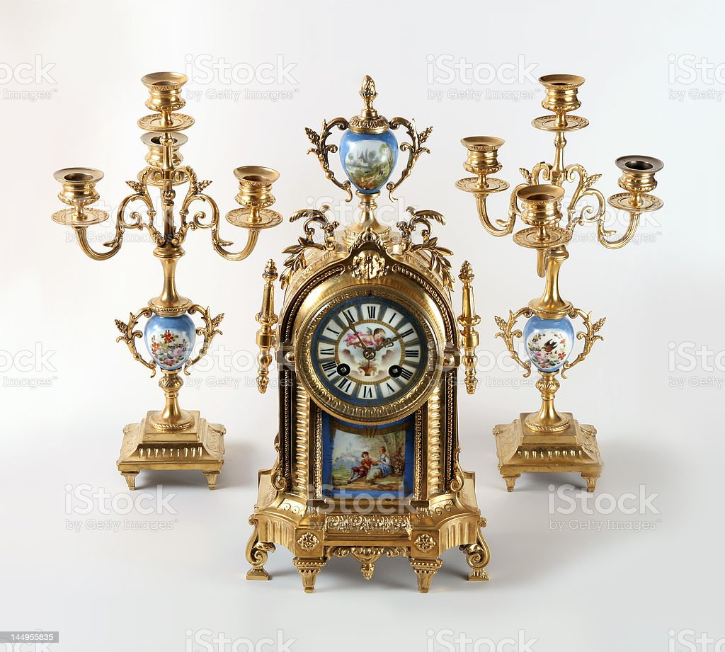 Antique clock with two sconces stock photo