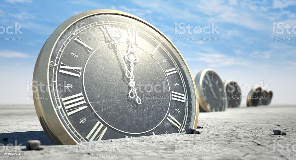 Antique Clocks In Desert Sand stock photo